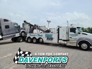 Davenports' heavy towing wrecker gently pivoting the semi cab for a safe un-decking